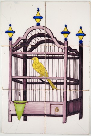 Antique Delft tile mural with a polychrome canary in a bird cage, 19th century
