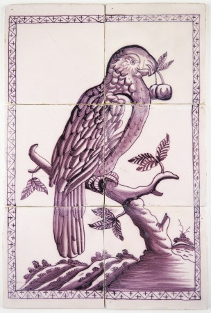 Antique Delft tile mural with a beautiful parrot holding berries in its beak, 18th century