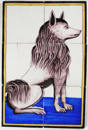Antique Dutch tile mural depicting a 'keeshond' or 'barge dog
