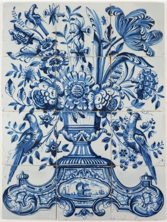 Antique Delft tile mural in blue with a richly decorated flower vase with a parrot on each side, 19th century Harlingen