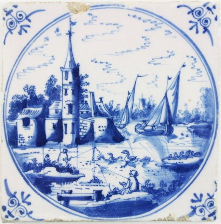 Antique Dutch Delft landscape tile in blue with boats, a village and men fishing, 18th century