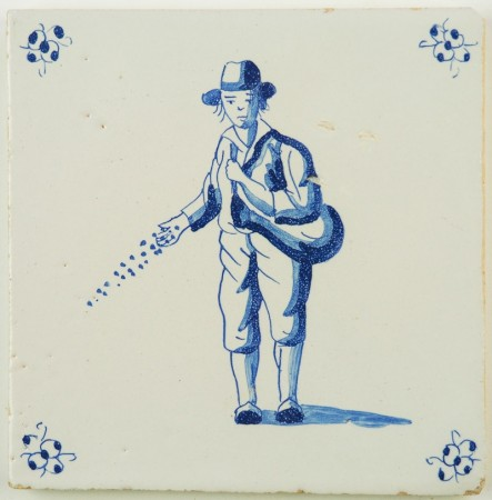Antique Delft tile in blue with a farmer sowing seeds, 18th century