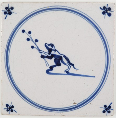 Antique Delft tile with a monkey holding a twig, 17th century