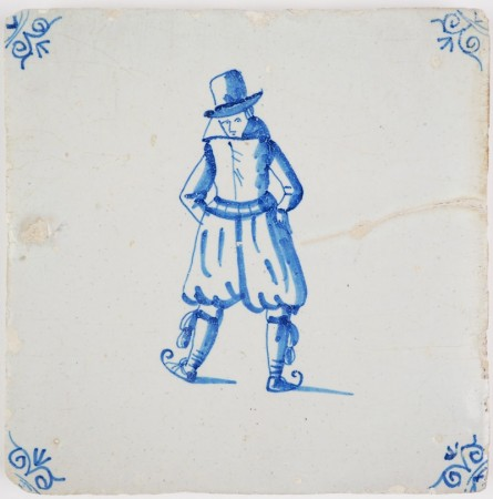 Antique Delft tile in blue with a man on ice skaters, 17th century Winter Scene