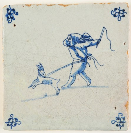 Antique Delft tile in blue depicting Cupid holding a goat on a leash, 17th century
