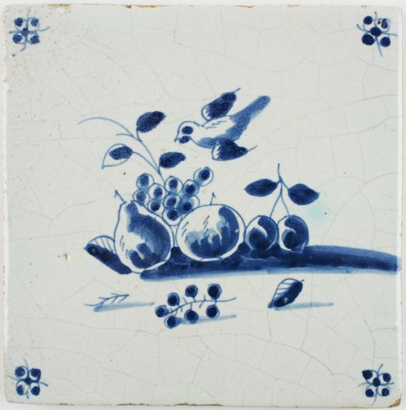 Antique Dutch tile in blue with a bird heading for fruits on the ground, 17th century