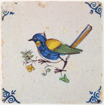 Antique Delft tile with a polychrome bird on a twig with flowers, 17th century