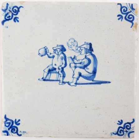 Antique Delft tile with two men in a tavern enjoying a drink and tobacco pipe, 17th century