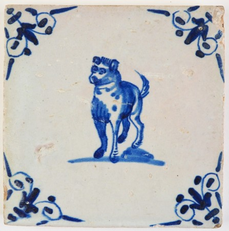 Antique Delft tile with a curious dog in blue, 17th century