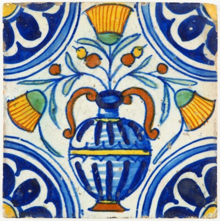 Antique Delft tile with a beautiful polychrome stylised flower pot, early 17th century