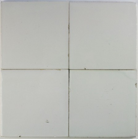 Plain white antique Dutch Delft tiles dating from around 1900