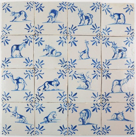 Antique Delft wall tiles with animals in blue and lily corner motifs, first half 17th century