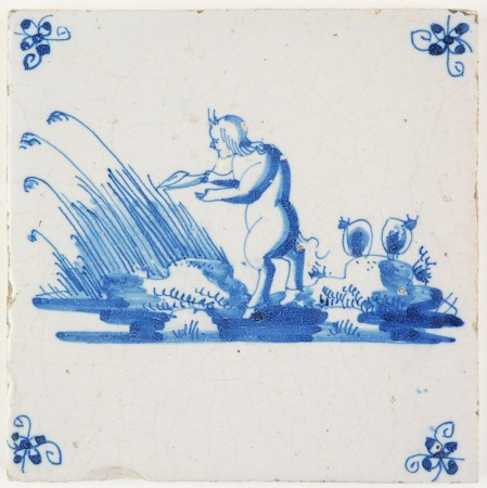 Antique Delft tile depicting the moment Pan makes pan pipes from Syrinx, who was transformed into hollow water reeds, 18th century
