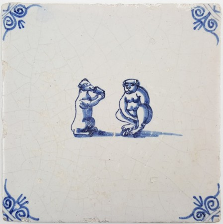 Antique Delft tile with two monkeys drinking from a cup, 17th century