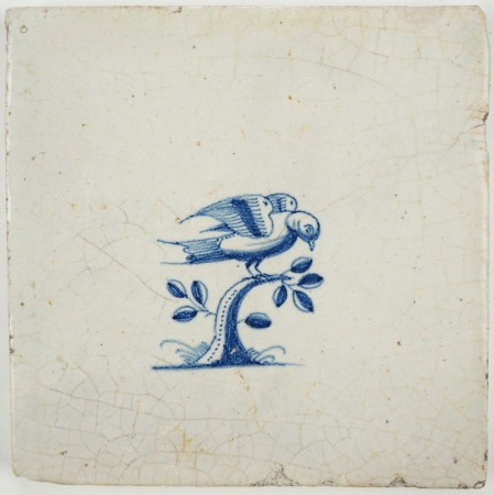 Antique Delft tile in blue with a bird on top of a tree, 17th century