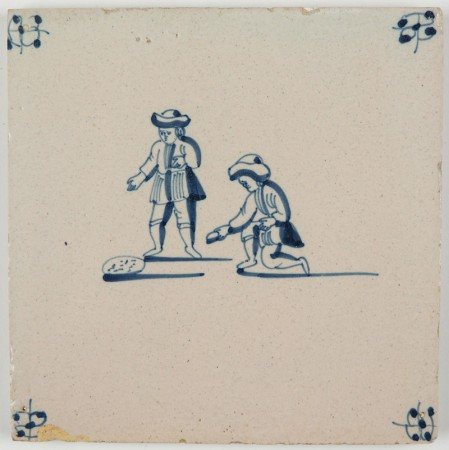 Antique Delft tile with two children playing a game of marbles, 18th century