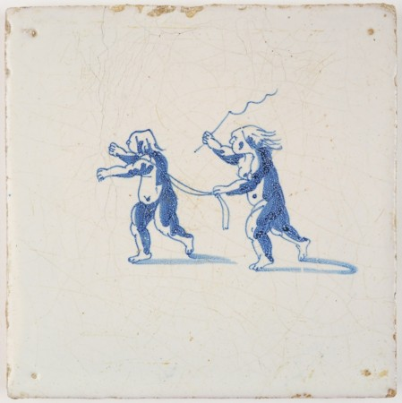 Antique Delft tile with two putti playing horse and rider, 17th century
