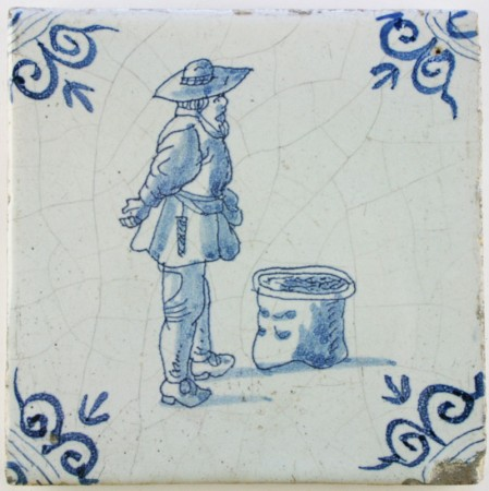 Antique Dutch Delft tile with a market vendor in blue, 17th century