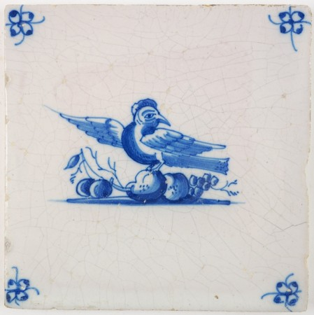 Antique Delft tile with a lovely bird on top of fruits, 18th century