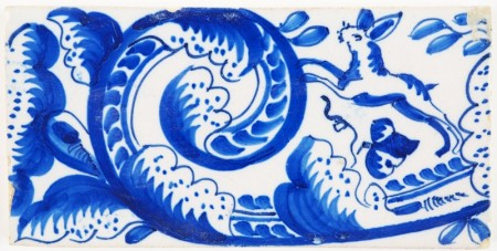 Antique Delft border tile with hares jumping through a garland of flowers, 19th century