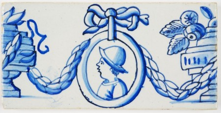 Antique Delft border tile with portraits, garlands and flower vases, 19th century