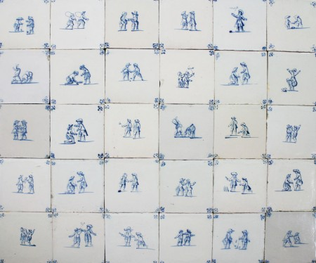 Antique Delft wall tiles with many different child's play scenes, 18th century