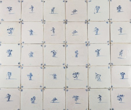 Set of antique Delft wall tiles with Cupids in blue, 17th century
