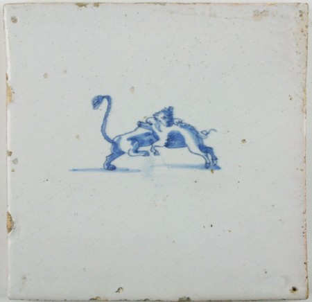Antique Dutch tile with a Lioness hunting a boar, 17th century
