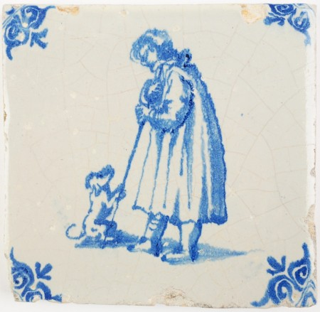 Antique Delft tile depicting a dog beggin for food or attention from a man, 17th century