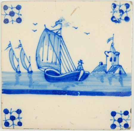 Antique Delft tile in blue with a sailing boat and a skipper, late 19th century
