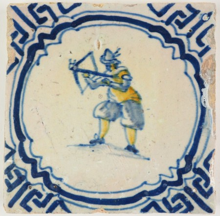 Antique Delft tile with a marksman shooting a crossbow, 17th century