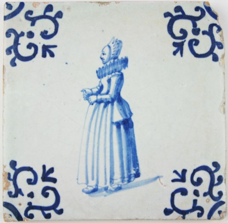 Dutch Delft tile with a lady wearing a folk costume