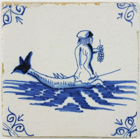 Antique Delft tile in blue with a merman holding a bunch of onions or garlic, 17th century