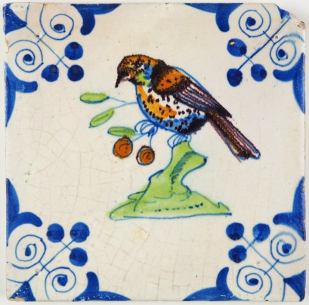 Antique Delft tile with a beautiful polychrome bird, 17th century