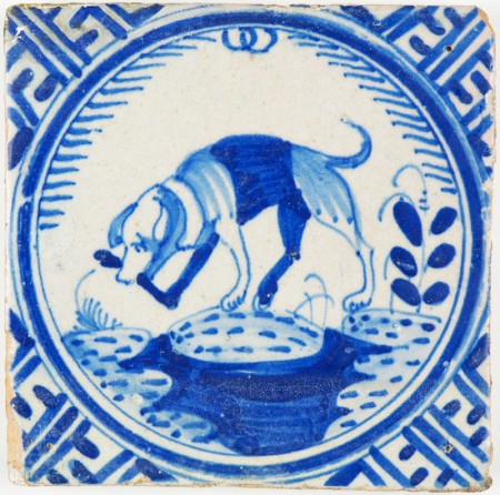 Antique Dutch crown tile with a Dog chewing on a bone, 17th century