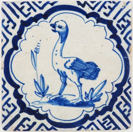 Antique Delft tile with an ostrich in a scalloped border inspired by Wanli motifs, 17th century