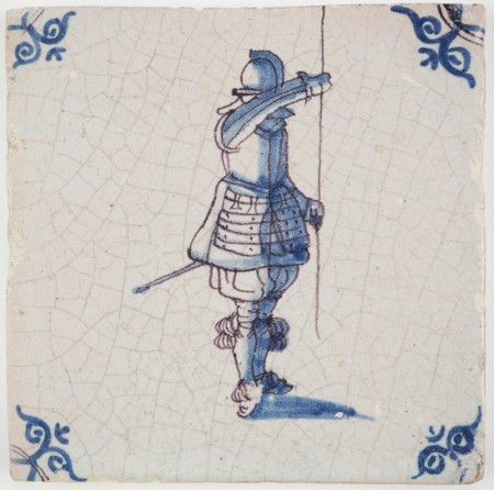 Antique Delft tile with a pikeman in bue and manganese, 17th century