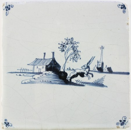 Antique Dutch Delft wall tile with a landscape and a hare in blue