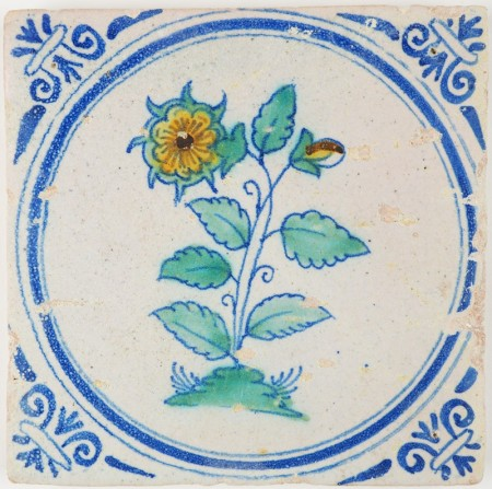 Antique Delft tile with a polychrome rose in a circle, 17th century