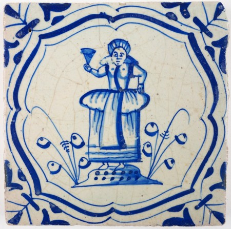 Antique Delft tile in blue with a lady raising her glass, 17th century
