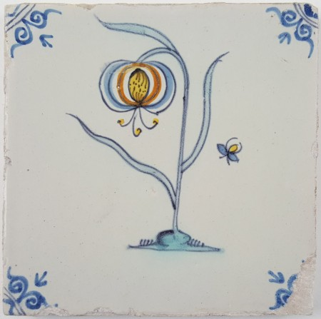 Antique Delft tile with a polychrome flower with a small bug flying next to it - V, 17th century