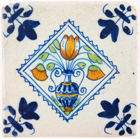 Antique Delft tile with a tulip in a flower pot in a diamond square, 17th century