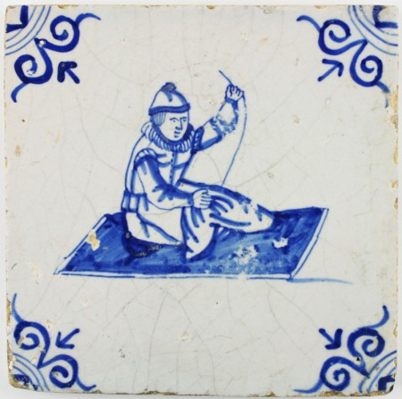 Antique Dutch tile in blue with a tailor, 17th century