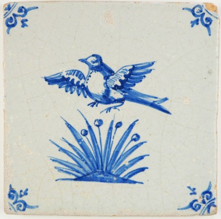 Antique Delft tile with a bird flying from the high grass and becoming a target for the hunter, 17th century
