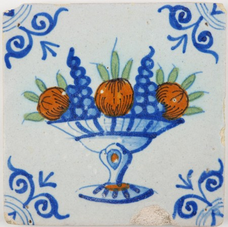 Antique Delft tile with a polychrome fruit bowl, first half 17th century