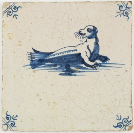 Antique Dutch Delft tile in blue with a seal, 17th century