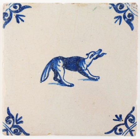 Antique Delft tile in blue with a dog barking viscously, 17th century