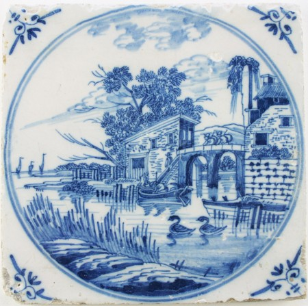 Antique Dutch Delft landscape tile in blue depicting a harbor scene