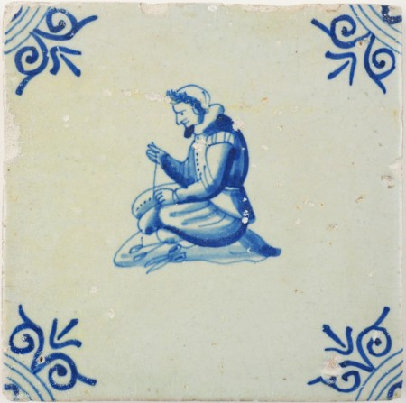 Antique Delft tile in blue with a tailor, 17th century
