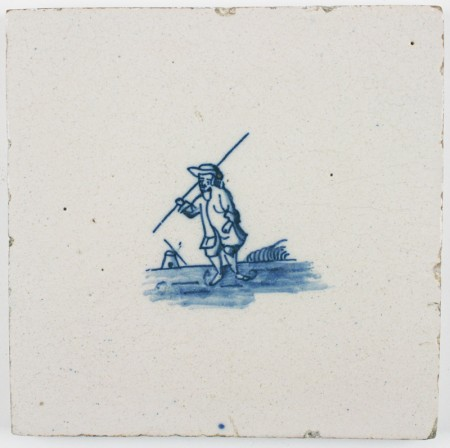 Antique Delft tile with an ice skater in blue, 18th century